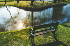 A bench with nature at Sunset. In the garden Stock Photos