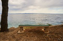 Bench near Adriatic sea. Royalty Free Stock Photo
