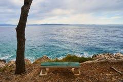 Bench near Adriatic sea. Stock Image