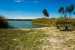 Bench near the bay of the lake Royalty Free Stock Photography