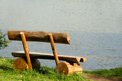 Bench near a lake. Wodden bench near a lake during summer Royalty Free Stock Photography