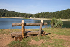 Bench near lake. Beautiful mystical lake. Black Lake, Durmitor National Park. Montenegro Stock Photography