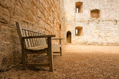 Bench near a medieval wall stock photo