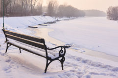 Bench near river. Royalty Free Stock Images