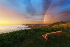 Bench near Sopelana coast with rainbow Stock Image