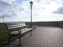 The bench next to the wall with unreachable views of the Danube and Novi Sad from the Petrovaradin Fortress. Serbia Royalty Free Stock Image