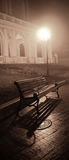 Bench in night alley with lights Royalty Free Stock Images