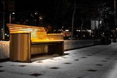 Bench at Night. Lit bench on sidewalk at night Royalty Free Stock Image