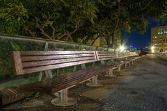 Bench in the night. Long bench in the night Stock Photography