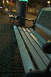 Bench at night after rain Stock Images