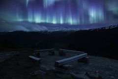 A bench in Norwegian National park with aurora. A bench in Norwegian National park at night Stock Image