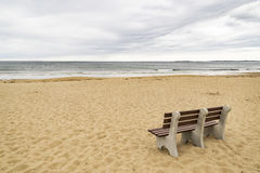 Bench on ocean beach Royalty Free Stock Images