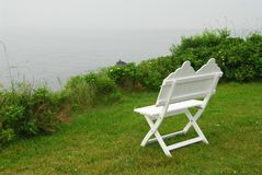 Bench on ocean shore Royalty Free Stock Photography