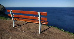 Bench with an ocean view. A wooden bench offering beautiful ocean view Stock Photo