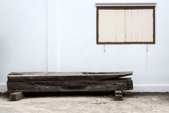 Bench. Old bench and white wall with window Royalty Free Stock Photos