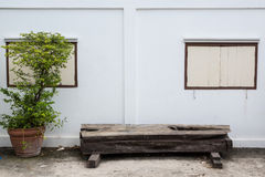 Bench. Old bench and white wall with window Stock Images