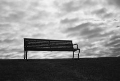Bench With Ominous Sky Royalty Free Stock Photography