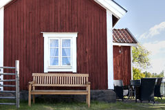 Bench outdoors. A nice wooden house with a bench below the window Stock Images