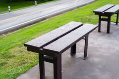 Bench over the road Royalty Free Stock Images