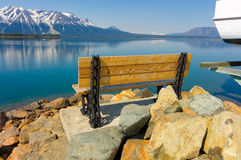 A bench overlooking atlin lake in northern canada Royalty Free Stock Images