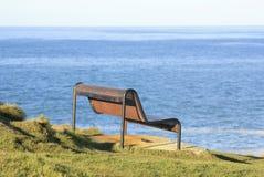 Bench overlooking beach Royalty Free Stock Photos