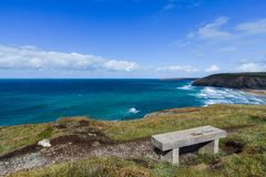 Bench Overlooking Cornwall Coastline. Bench overlooking coastline from Mawgan Porth to Newquay in Cornwall, England royalty free stock images
