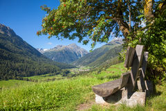 Bench overlooking Engadin Valley in Swiss Alps Royalty Free Stock Images