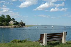 Bench Overlooking Essex River. Bench overlook the Essex River, Essex, MA, on a clear summer day royalty free stock photo