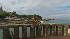 Bench overlooking the islet Rocher Du Basta 05 stock footage