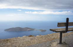 Bench overlooking the Islet of Samiopoula. Stock Images