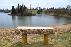 Bench overlooking a lake Stock Images