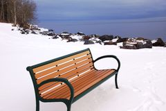 Bench overlooking Lake Superior in the winter Stock Images