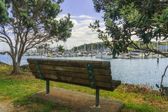Bench overlooking the marina Stock Images