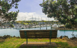 Bench overlooking the marina Stock Image