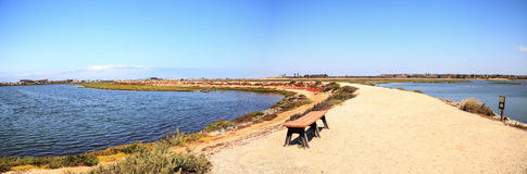 Bench overlooking the peaceful and tranquil marsh of Bolsa Chica wetlands. In Huntington Beach, California, USA stock photos
