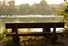 Bench overlooking river Stock Photography