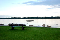 Bench overlooking river or sea Royalty Free Stock Photo