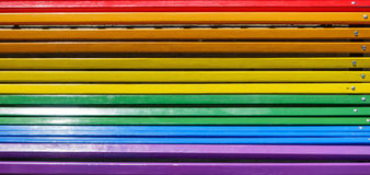 Bench painted with rainbow colors. Closeup of bench painted with rainbow colors royalty free stock image