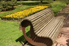 A bench in the park royalty free stock images