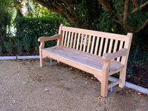 A bench in a park Royalty Free Stock Image