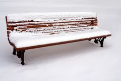 A bench in the park. A bench in the park, covered with snow Stock Photography