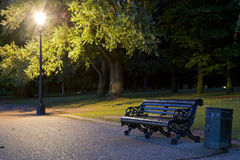 Bench in the park. A night photo of a bench in a park Royalty Free Stock Photo