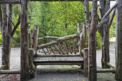 Bench in the Park. Wooden bench in Prospect Park, Brooklyn NY. Green background Royalty Free Stock Images