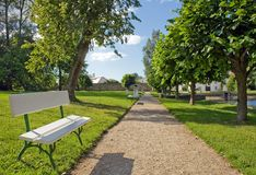 Bench in the park. Bench by the park path on a sunny day Stock Images