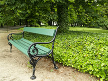 Bench In Park. Small green bench in park on poland Stock Photos