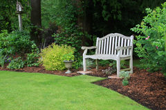 Bench in the park. Wooden bench in a beautiful park garden Royalty Free Stock Photo