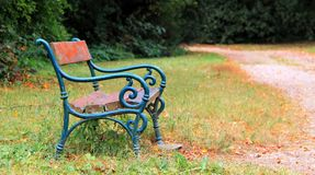 Bench in a park. Autumn background. Blue wooden bench in a autumn park Royalty Free Stock Images