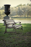 Bench in the park on a background of lake Royalty Free Stock Photography
