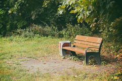 Bench in park. With bin Stock Photo