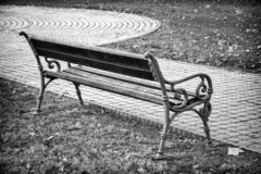 Bench in the park in black and white